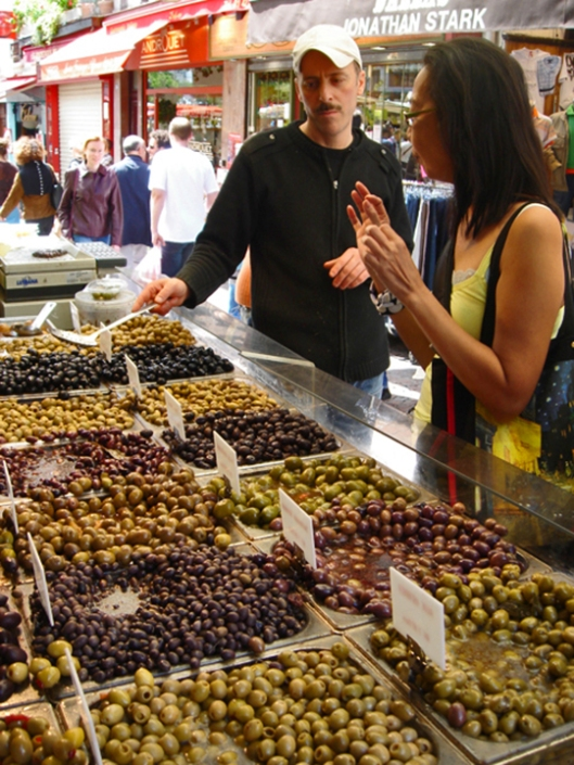 Sampling a range of olives at the Rue de Mouffetard